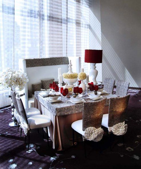 Animal Prints; Animal print linens featuring cream button mums and phalaenopsis orchids with accents of red in the glassware and lampshade