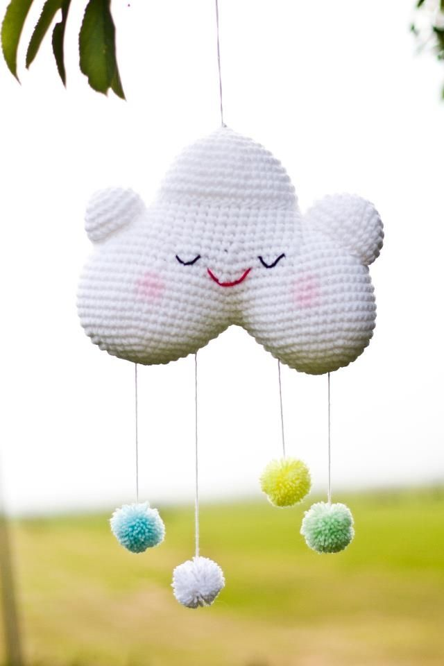 This cute little crochet cloud mobile is available for purchase via the website Coccinella.  This little thing makes me happy!  :)