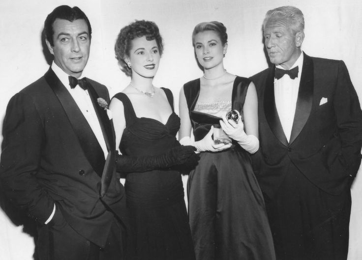 """gracie-bird:  """"GOLDEN GLOBES 1954: Grace Kelly won a Globe as best supporting actress for her work in Mogambo, and received it from the hands of Robert Taylor and Eleanor Powell. Spencer Tracy won the best actor Golden Glove for his performance in The..."""