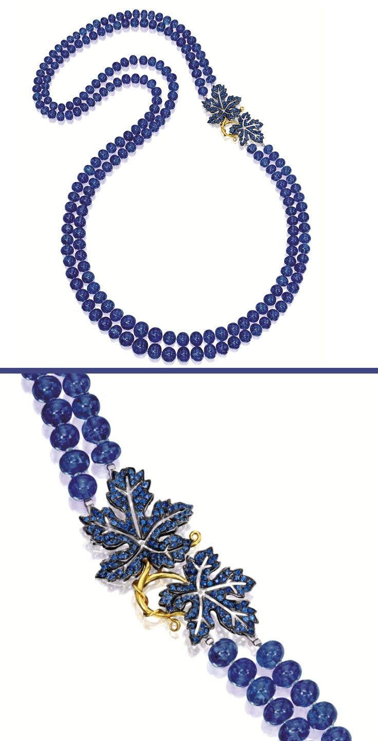 TANZANITE AND SAPPHIRE NECKLACE.  The double-stranded necklace composed of two hundred and ten tanzanite beads together weighing approximately 907.00 carats, completed by a clasp decorated by two leaves set with circular-cut sapphires together weighing approximately 3.15 carats, mounted in 18 karat yellow and blackened gold, length approximately 820mm