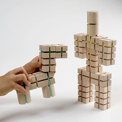 This is a kit, but I can't help thinking that you could do something similar with (small) boxes (and other small objects)  sandwiched between flat cardboard pieces with notched edges.