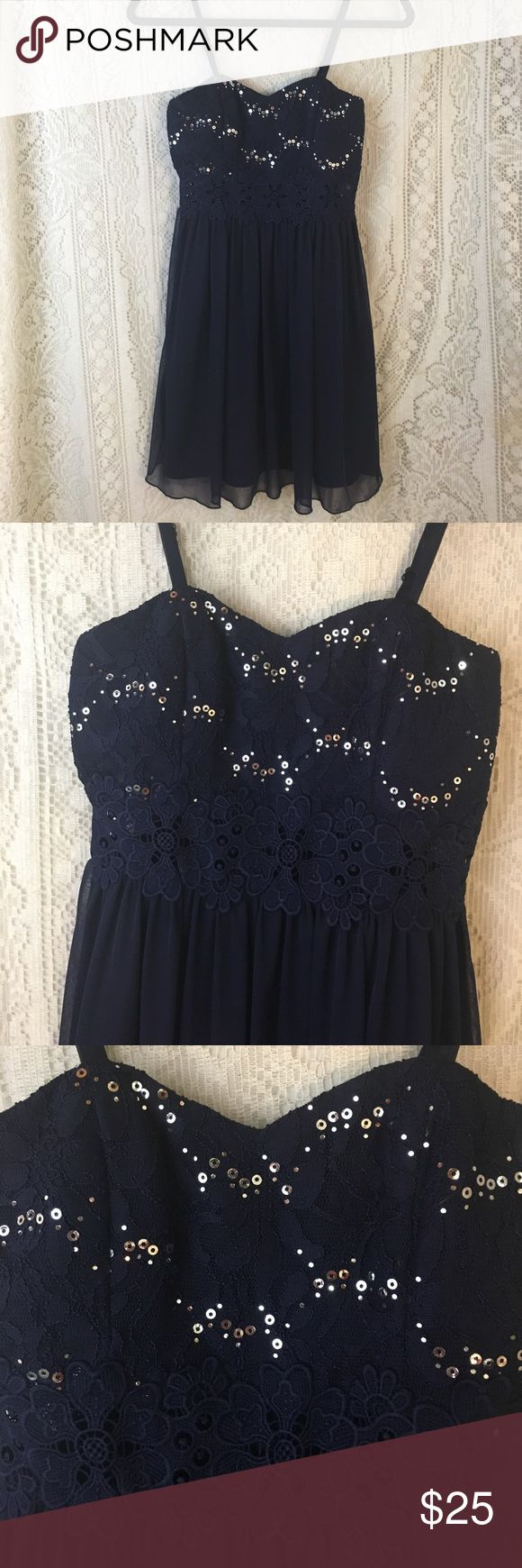 "Short navy formal dress w sequins sz 1 Worn once. Navy blue polyester with silver sequins on the lace bodice front and back. All sequins intact. 1.5"" of lace at the waist will show skin. Adjustable spaghetti straps. Bodice and skirt are fully lined. lined. Hand washable. Lightly padded cups. Fully functional back zipper. 15"" armpit to armpit. 33"" shoulder to hem. EUC from a smoke free home. by & by Dresses Prom"