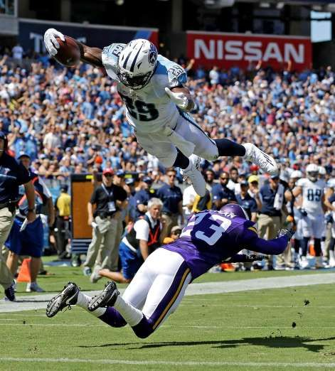 Tennessee Titans running back DeMarco Murray (29) dives over Minnesota Vikings cornerback Terence Newman (23) as Murray scores a touchdown on a 6-yard pass reception in the first half of an NFL football game Sunday, Sept. 11, 2016, in Nashville, Tenn.