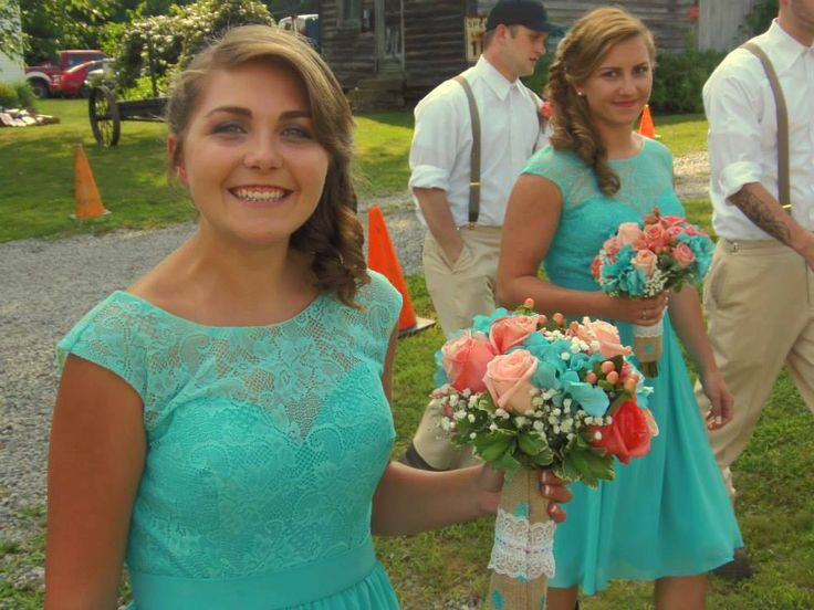"Bouquets of coral ""Engagement"" and ""Movie Star"" roses with ""Ilse"" spray roses, peach hypericum berries, jade hydrangeas, baby's breath and variegated pittisporum wrapped in burlap and lace compliment ""Tiffany"" (or turquoise) bridesmaid dresses"