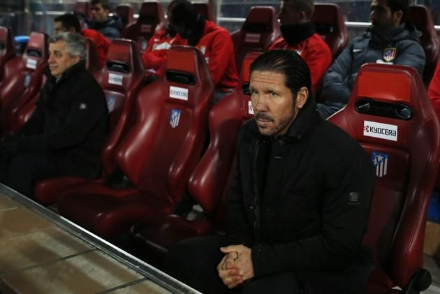 Atletico's coach Diego Simeone watches a Spanish La Liga soccer match between Atletico de Madrid and FC Barcelona at the Vicente Caldero...