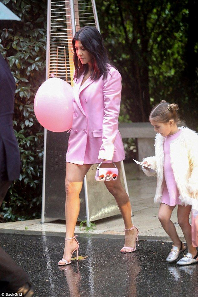 b22dfa54d14c Sweethearts: Kourtney's gorgeous gams glistened under the afternoon sun as  she walked to her car wearing a thigh-skimming pink blazer