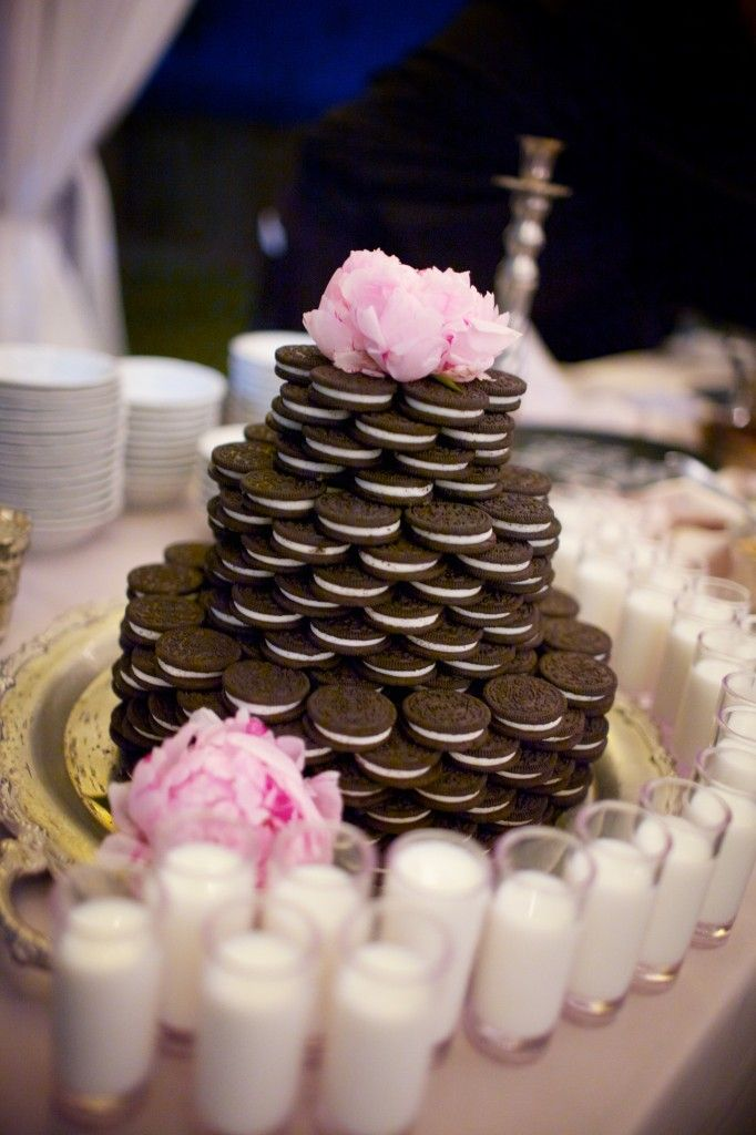 oreo cake with peony floral topper and shotglasses of milk