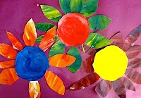 colorwheel flowers.  Three circles in primary colors.  Then 12x18 divided into 3 sections for secondary colors.  Primary colors will be center of flowers and secondary colors are petals.