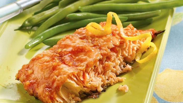 A sweet-and-spicy basting sauce beautifully coats salmon fillets for a fast and flavorful main dish.