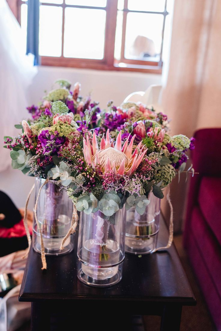 Bridesmaids bouquets. Proteas and penny gum love. Pink, purple and guinea fowl feathers