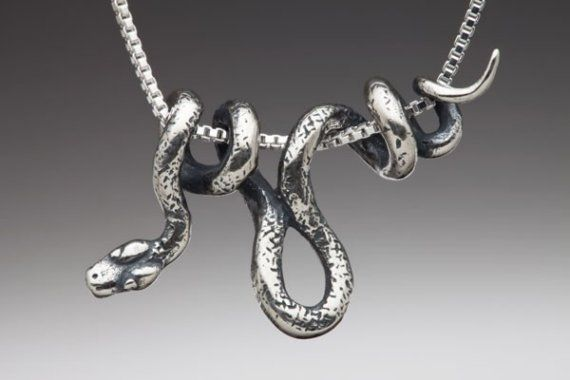 "This sinuous, solid sterling silver Vine Snake wraps gracefully along it's ""vine"" chain. The Snake is 1 3/8"" long and completely three dimentional. -From Etsy"