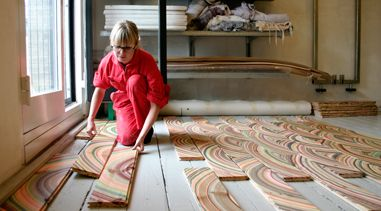 Designer Pernille Snedker Hansen uses a repurposed marbling technique on wooden planks giving each one a unique and vibrant pattern that is stunning especially when tiled along the floor.