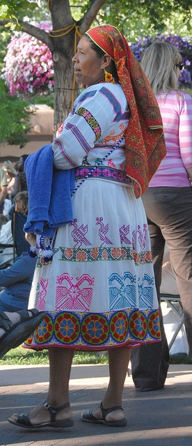 Huichol Woman    This Huichol artist from Nayarit, Mexico wears a skirt and blouse decorated with intricate hand embroidery. Santa Fe, New Mexico
