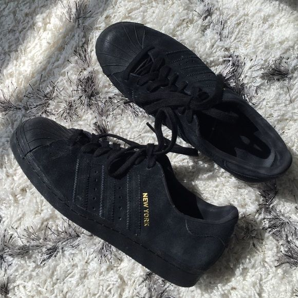 """All black suede New York // City Adidas Superstars Worn twice without box, in new condition. Black on black with gold foil """"New York"""" on outer sides and Statue of Liberty on back heel. WOMENS 9/ MENS 7.5 Adidas Shoes Sneakers"""