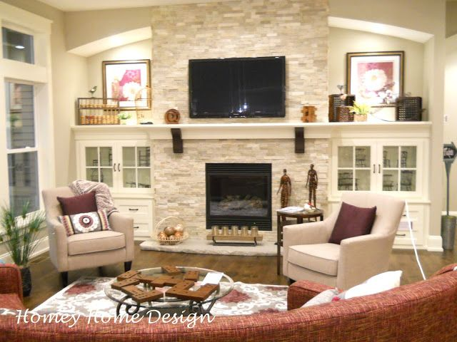 LOVE the lighting, shelves and cabinets on either side of the fireplace