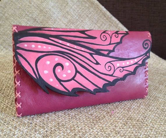 genuine leather in pink color. It's painted with special leather colors and burned with a pyrographer.  Dimentions: 15cm x 20cm