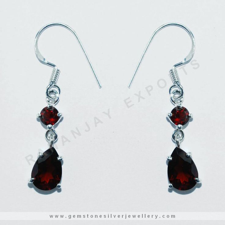 High Fashion danglers  Simple yet sophisticated! The round cut & hanging pear cut gemstone with contrast colored silver contours in the earrings compliments each other very well .The collection is suitably priced and is ready to ship at your doorstep.