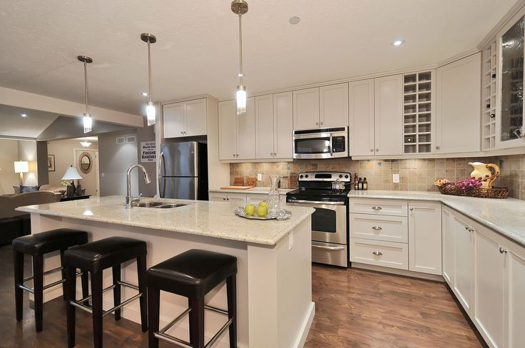 The Trent - open concept kitchen, dining, living.  Great ideas for a cottage or retirement home.    www.qualityhomes.ca