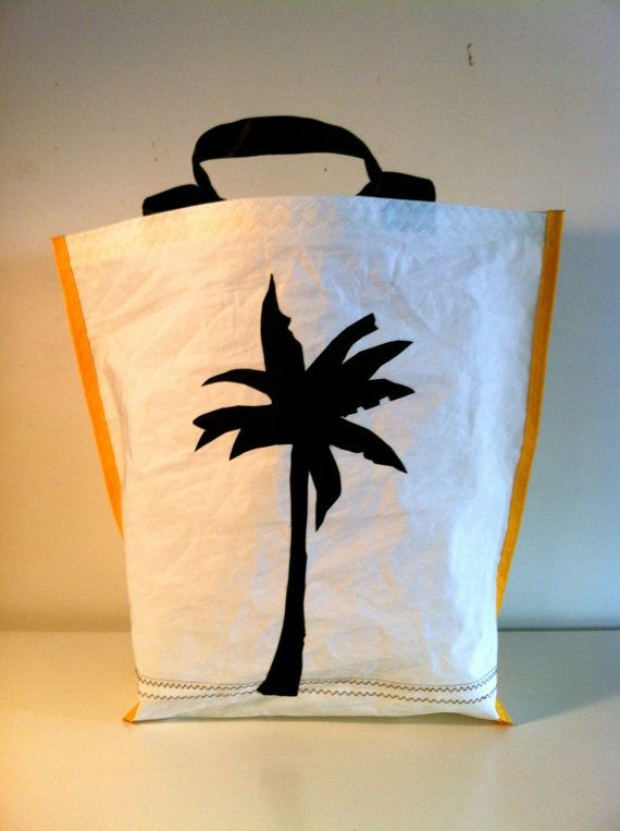 Medium open tote in the Spirit of Tropical North Queensland with the classic Palm tree silhouette.<br>The interior of this tote is in it's natural state, <br>Black shoulder straps.<br>approx 24' long..1' width all individually hand cut and hand stitched  using traditional sailmaking skills.<br><br>...
