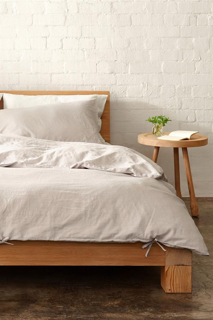 This reversible Duvet Set is made from a breathable linen cotton blend that's been enzyme washed for a unique distressed look and feel. Each of the six designs (three printed, three solid) feature distinctive fabric ties with each set containing one duvet and two standard pillowcases. Composition: 52% Linen 48% Cotton. Sizing Guide: Cover - 210x210cm. Pillowcases - 48x74cm.