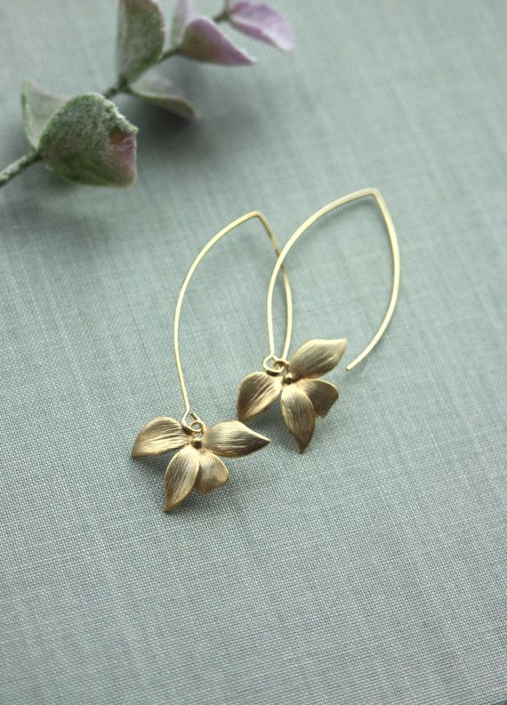 Pretty matte gold plated over brass orchid flower charms which hangs on long gold plated over brass large marquise ear