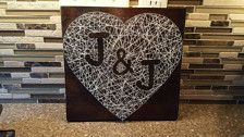 Made with: wood, nails, string  Made to order: (Choose) -Dark or light stain -String color -Initials