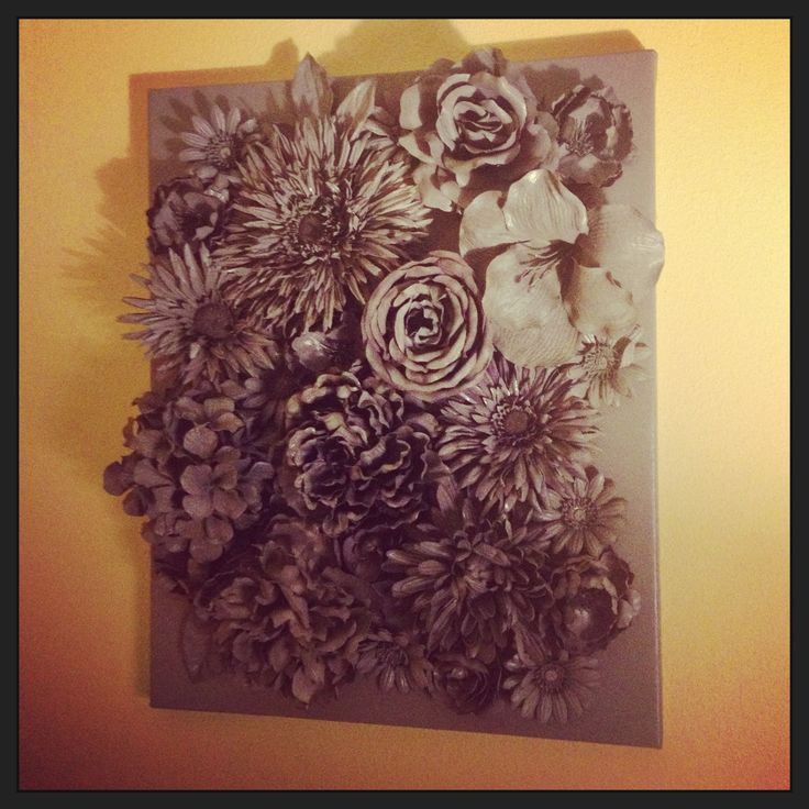 Faux flowers hot glued to canvas spray painted with krylon gray more