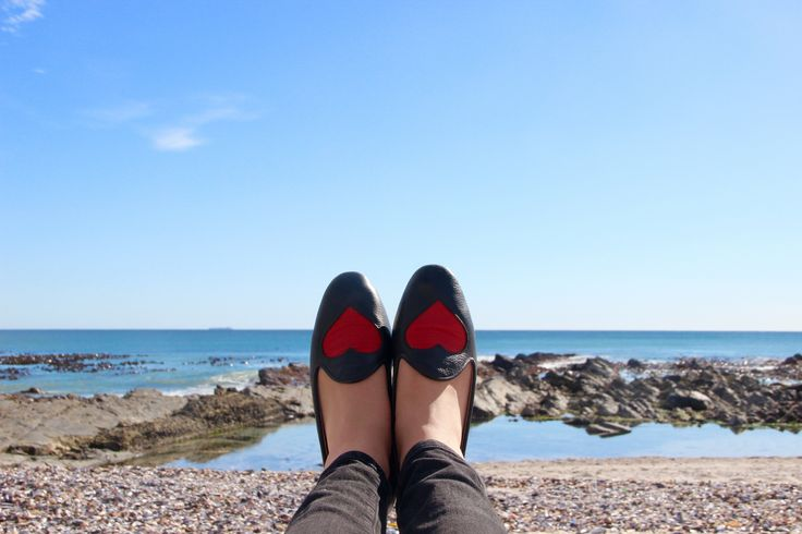 Heart slippers on the beachfront