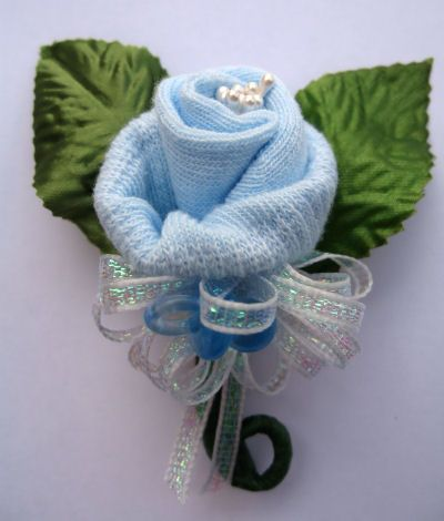 Mini Baby Sock Corsage for Momma-to-Be  I use some artificail baby's breath in mine