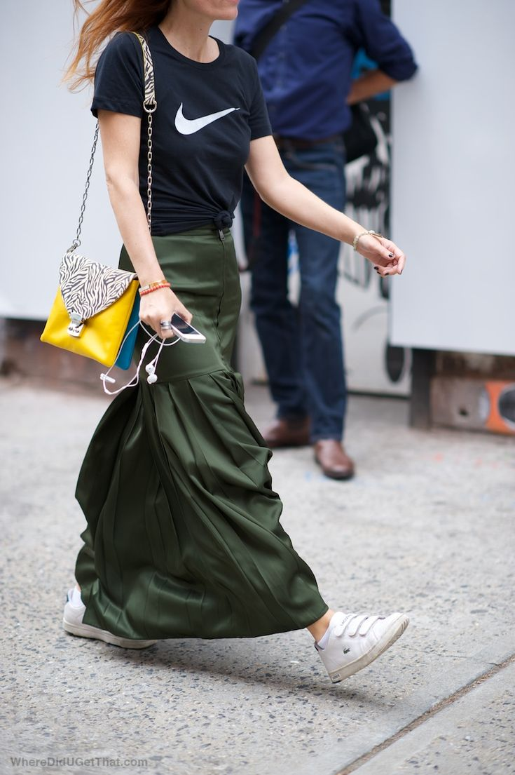 The skirt is by Fendi. The t-shirt is by Nike. The shoes are Lacoste. Natalie is wearing a...
