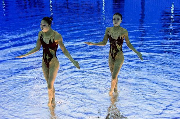 Olympic Synchronized Swimmers Upside Down by Huffington Post AP Getty