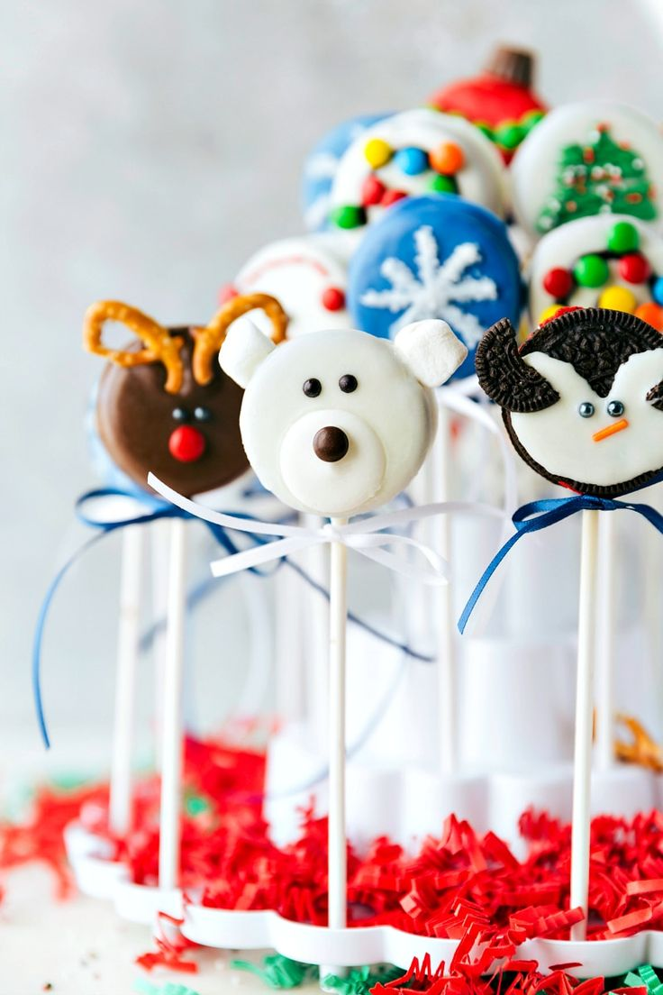 4 adorable and simple to make Christmas oreo pops: a snowman, a Christmas tree, an ornament, and a polar bear. via chelseasmessyapron.com