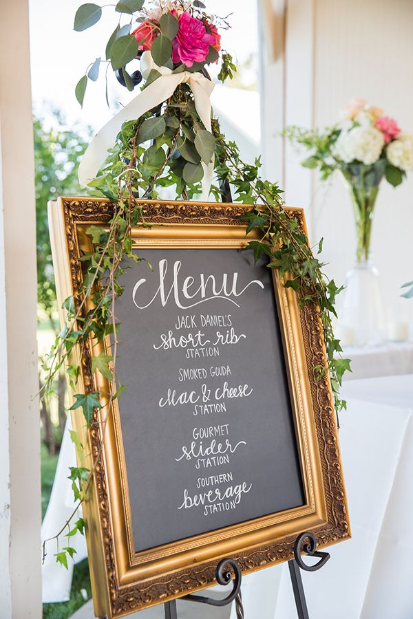 chalkboard wedding menu with a flower garland