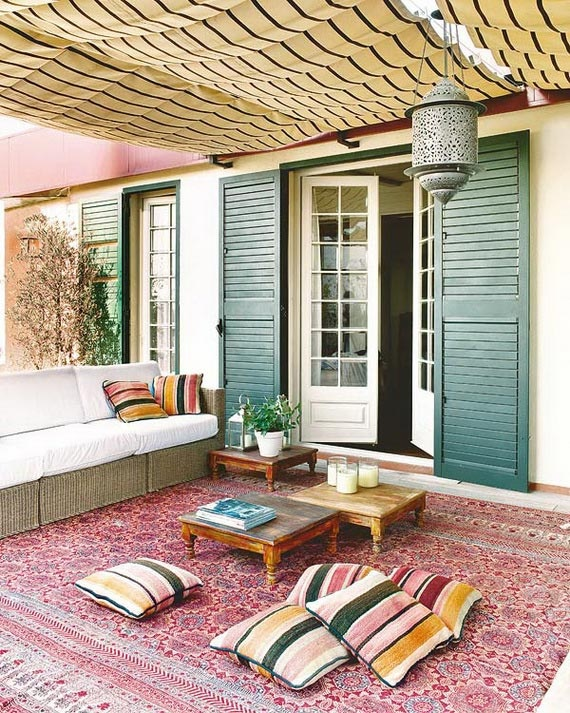 Outdoor space inspired by Turkish short coffee tables, bright colors, and traditional rug.