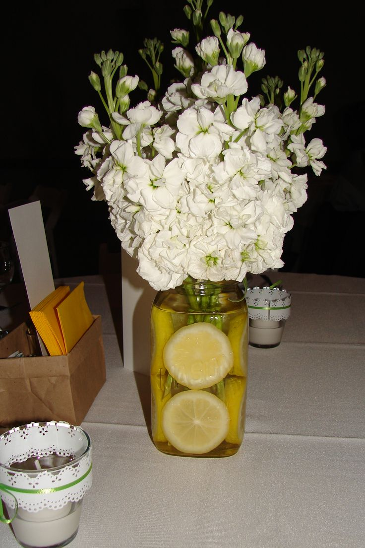 Beautiful Centrepieces - sliced lemons in a mason jar and add your favourite flowers