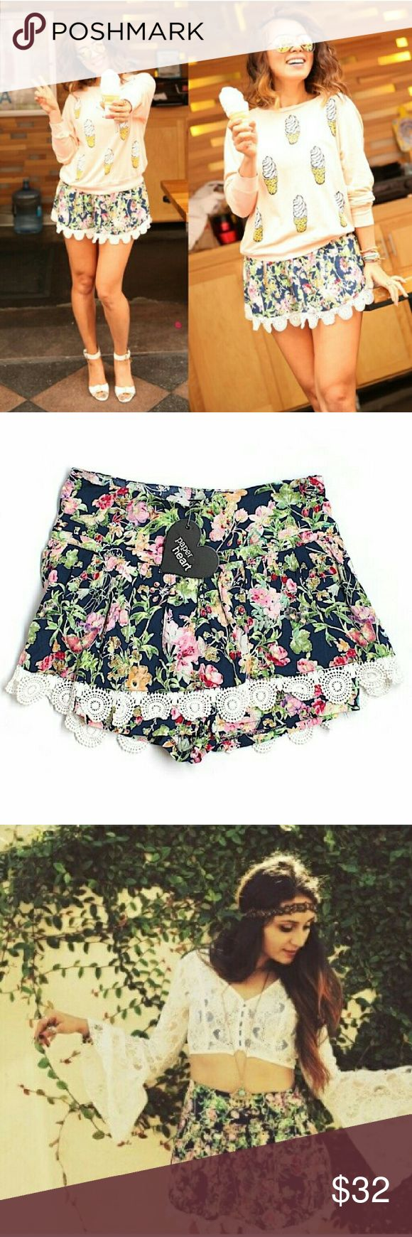 NWT LF XS S Navy Floral Crochet Hem Skort Shorts Brand new w/ tags. Girly boho festival skirted shorts in navy w/ pink, red, & green strawberry & butterfly floral print. Crochet hem detail. Side zip. 100% Viscose. Retailed at LF for $120. By Paper Heart. Selling several sizes. See comment for measurements.   I'm also selling this skort in different prints & sizes as well as bandeau top.   Please check out my closet for more NWT LF items to bundle w/ discount & save more with 1 shipping fee…