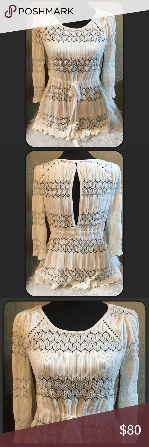 """🆕🍒Price Drop🍒Free People White Top Beautiful Free a people white Knit crochet style top with Key hole back. Had drawstring at waist area to tighten or leave loose. I ordered this online and I missed the return date. Size Small. Measures approximately 25"""" long, armpit to armpit 17"""" lying flat. Labeling as NWT I ordered thru Free People Online and it did not come with a tag. Never worn. This is new without tag. Price firm💕 Free People Tops"""