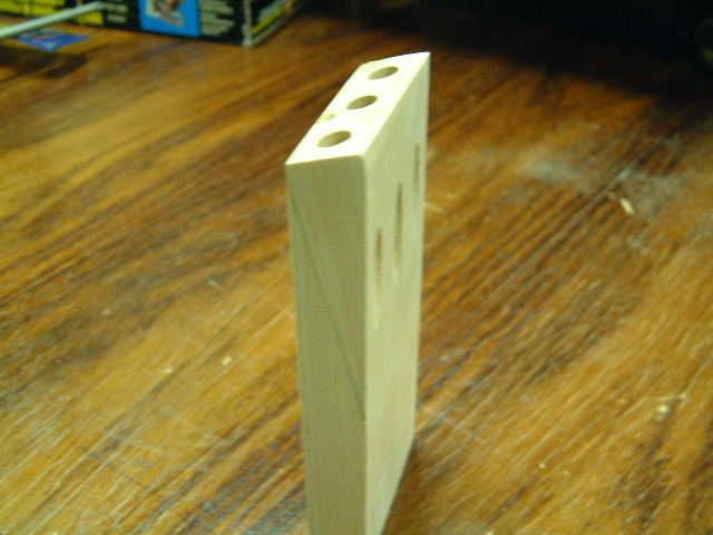 Pocket Hole jig is nothing but a piece of hardwood block with a set of holes drilled at 15 degree angle.