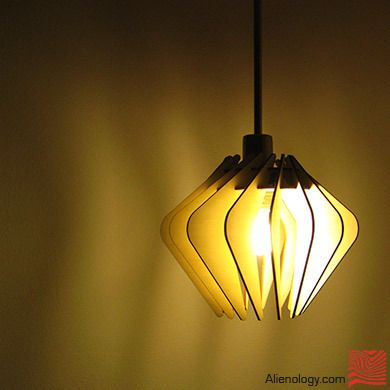 """This version of the lamp is made out of Eurolite plywood and it can be assembled in about 10 – 15 minutes. Ships flatpack.    This lamp is meant to be """"swag style"""" hanging lamp, perfect for mounting in a living room corner."""