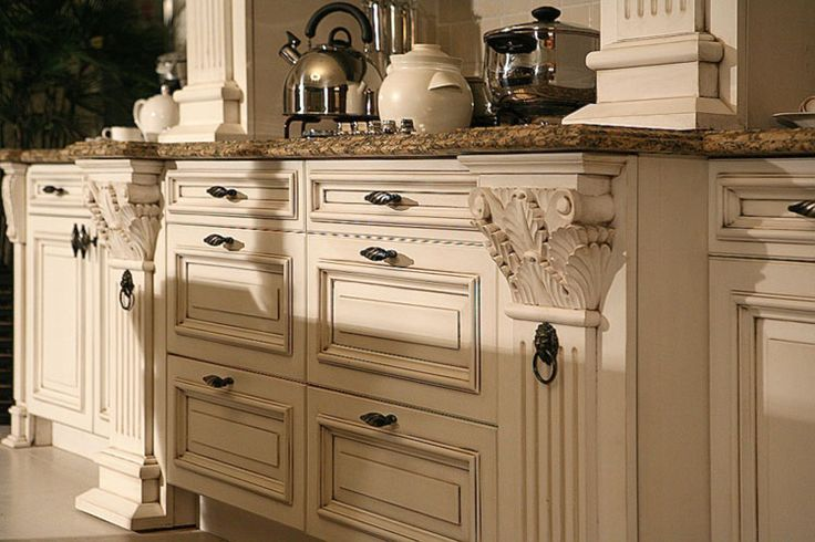 Paint and distress kitchen cabinets in cream kitchen for Antique ivory kitchen cabinets