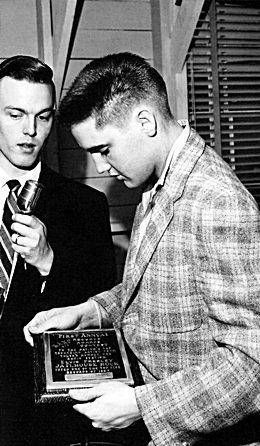 Elvis receiving an award for Jailhouse Rock been voted one of the top five records and 1957.