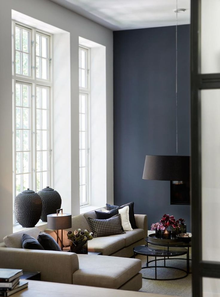Greyish blue wall looks so elegant in this living space with beige sectional L shaped sofa