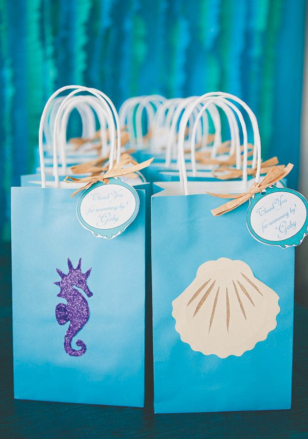 An Under the Sea First Birthday Party with chocolate seashells, clamshell cookies, DIY lantern jellyfish, floral coral reef centerpieces + a starfish topped sea pebble & fish scales cake
