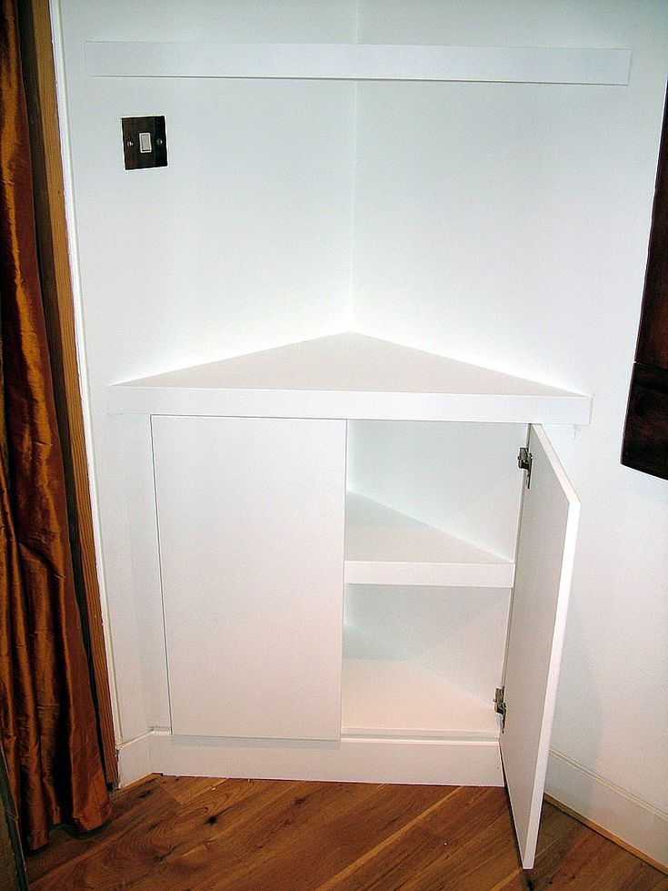 Impressive Triangular Corner Cupboard With Floating Shelves Feat Hardwood Flooring And Brown Curtains Awesome Floating Corner Shelf Ideas shelves corner wall. black corner floating shelves. glass corner cabinets. shower shelves corner. corner wall shelving unit. . 599x797 pixels