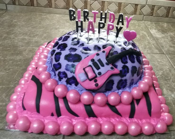 Girls zebra/cheetah birthday cake made with homemade fondant and hand painted cheetah spots. Guitar is hand made with fondant.