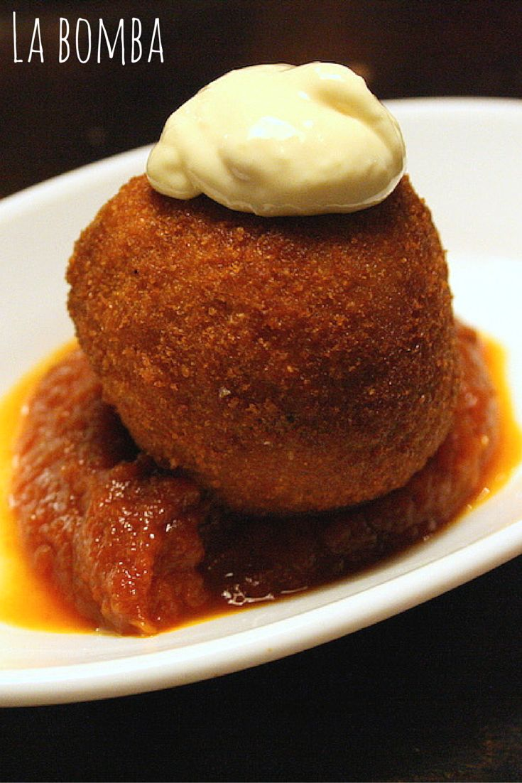 This is the Barcelona-only tapa: la bomba– a fried potato and minced meat croquette. Many tapas bars do them, few ace them. You can bet l'Anxoveta's is going to be one of the best in all of Barcelona. Find out where else to eat in Gracia neighborhood http://devourbarcelonafoodtours.com/eat-in-barcelona-gracia-neighborhood/