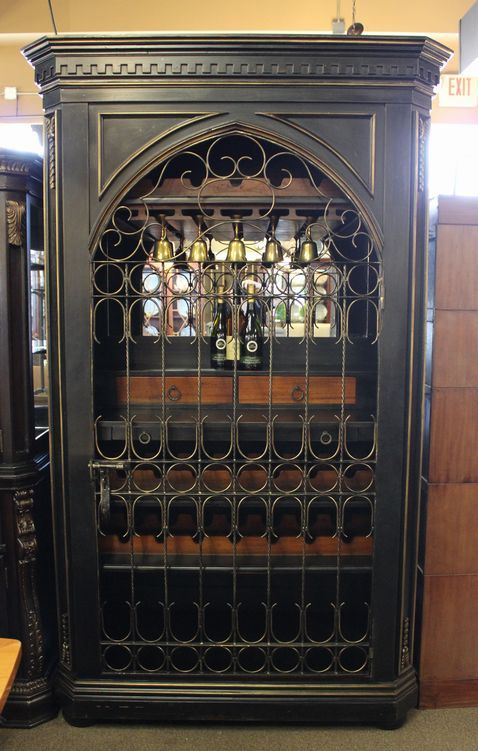 Beautiful Locking Wine Cabinet In A Black Finish With Arched Wrought Iron Door Mirrored Interior Gl Rack 3 Bottle Racks 2 Drawers