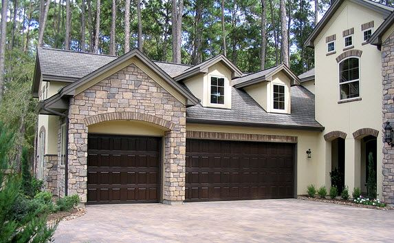 Beautiful faux wood garage door from www.wayne-dalton.com | This door has the appearance of wood but is made with a fiberglass exterior. | Garage Door Photo Gallery - Residential