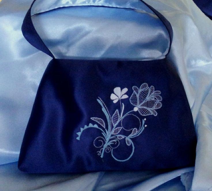 Handmade blue silk handbag with hand embroidered motif
