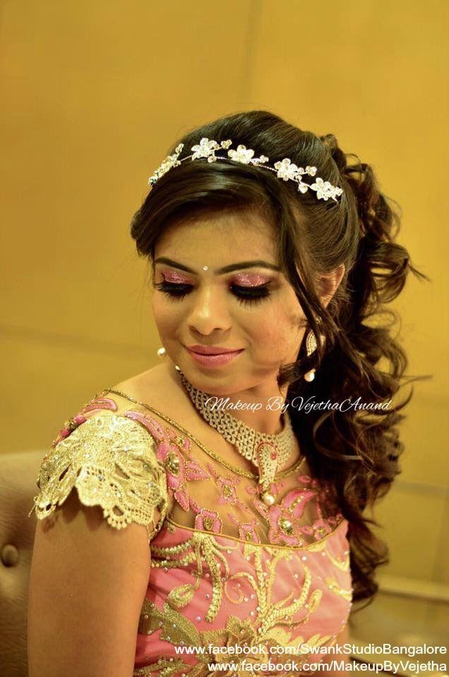 Indian bride's reception hairstyle by Swank Studio. Lehenga. Curls. Hair Accessory. Tamil bride. Telugu bride. Kannada bride. Hindu bride. Malayalee bride. Find us at https://www.facebook.com/SwankStudioBangalore